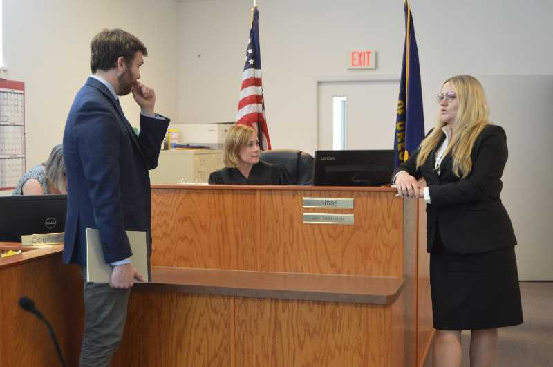 PMG PHOTO: NICOLE THILL-PACHECO - From left to right, City Prosecutor Sam Erskine, St. Helens Municipal Judge Amy Lindgren and defense attorney Jennifer Myrick chat briefly.