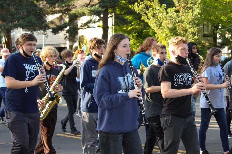 PMG PHOTO: MIA RYDER-MARKS - The Wilsonville High School's band performed the school's fight song at the annual Homecoming parade.