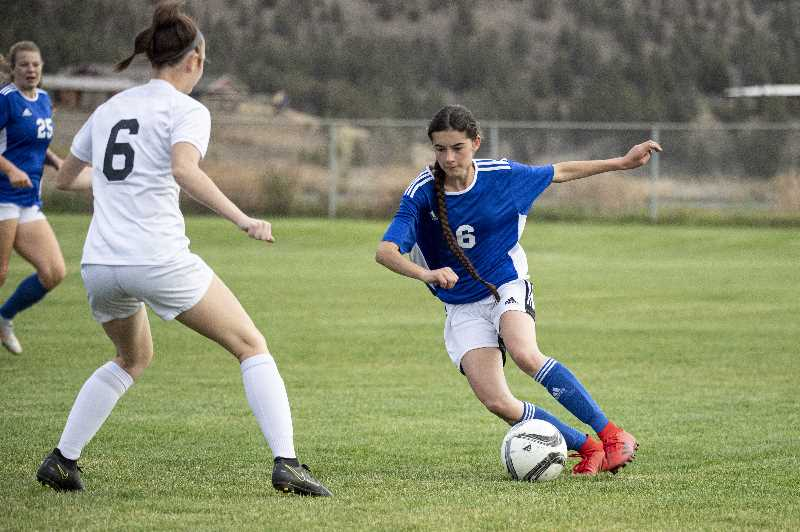 LON AUSTIN - Tavia Quinn moves the ball forward against Pendleton. The Cowgirls fell behind 4-0 at half and eventually lost 7-0. They play Redmond at home Thursday.