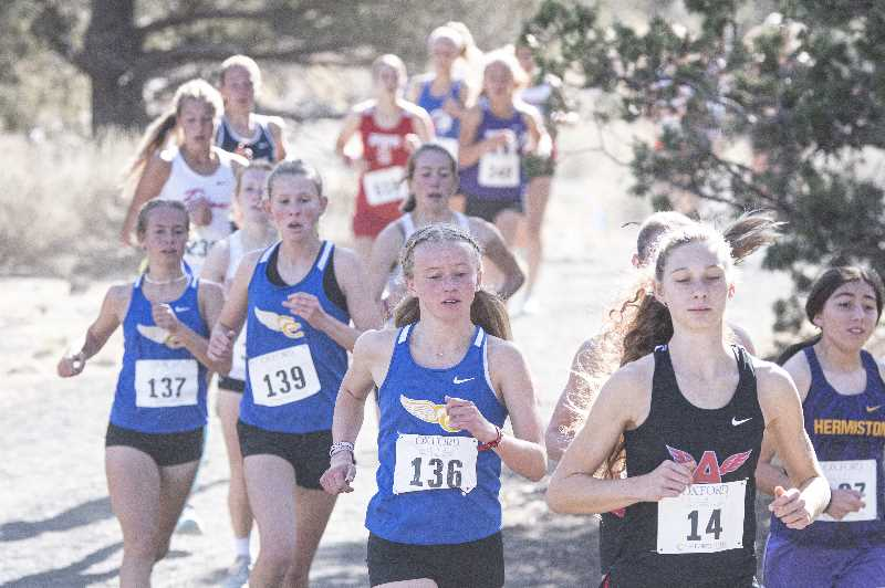 LON AUSTIN - Cowgirls Patagonia Carnie (136), McCall Woodward (139) and Elise Rice (137) run in a pack during the Oxford Classic in Bend Saturday. As a squad, the Cowgirls took sixth in the strong field. The trio of CCHS runners took 39th, 40th and 42nd individually.