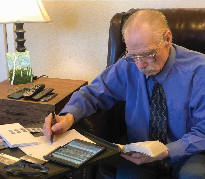 PHOTO COURTESY OF PAUL BERGGREN FAMILY, SUBMITTED BY PAUL WESTPHAL  - Paul Berggren participates in his voluntary ministry by writing a letter from his room at an assisted living facility in Redmond, Oregon.