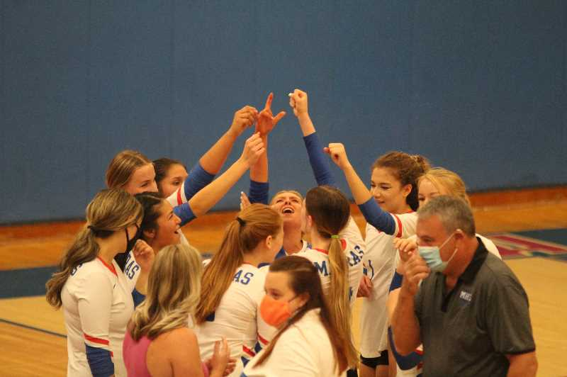 PMG PHOTO: ANDY DIECKHOFF - The Madras volleyball team won its first match in over two years on Saturday, beating 6A Benson in two sets.