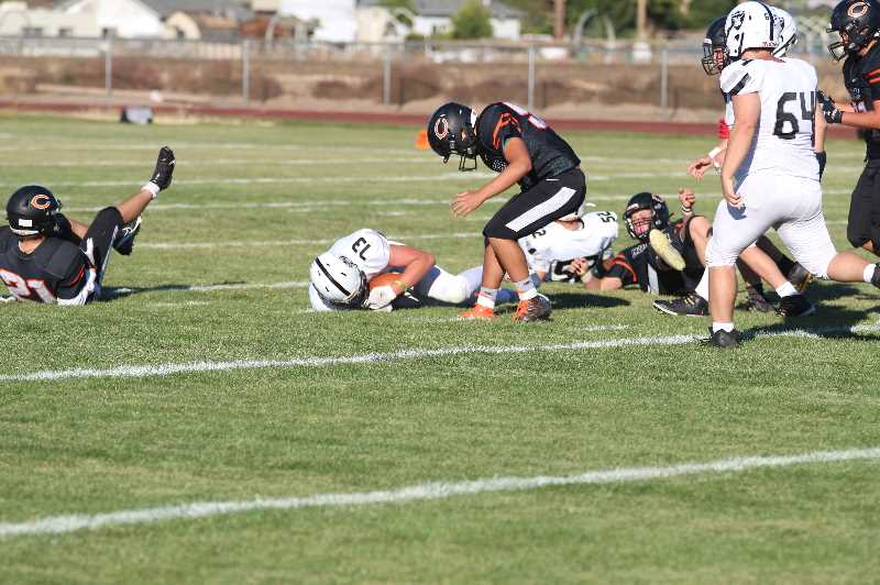 PMG PHOTO: ANDY DIECKHOFF - The Culver offense turned the ball over seven times against Salem Academy, including five lost fumbles.
