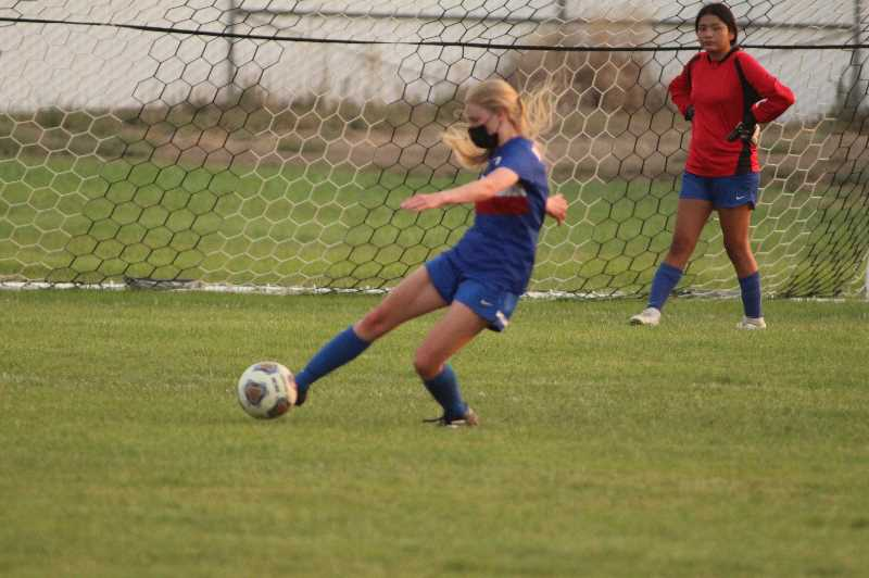 PMG PHOTO: ANDY DIECKHOFF - Brooke Delamarter, with ball, and Simyan David helped Madras to hold No. 5 Corbett to just one goal last week.