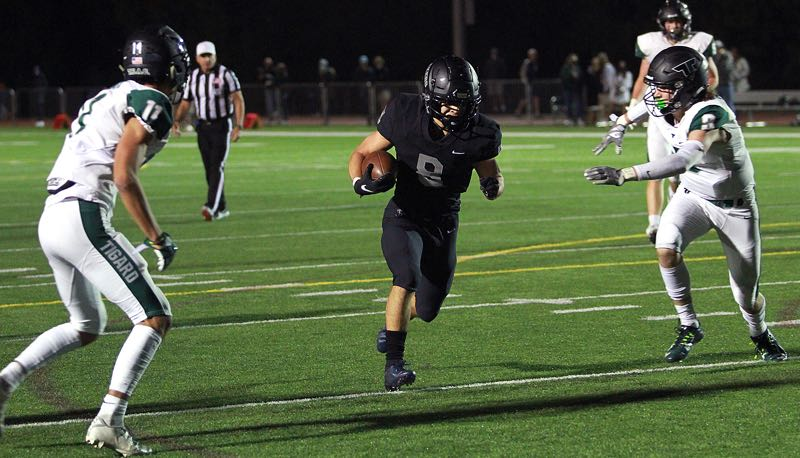 PMG PHOTO: MILES VANCE - Lake Oswego running back Gabe Olvera and the Lakers are unbeaten through five games, but still have contests left against West Linn, Tualatin and Lakeridge.