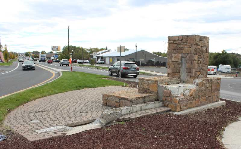 PMG PHOTO: HOLLY SCHOLZ   - Police are investigating an incident that damaged the wood and stone Welcome to Madras sign at the south Y.