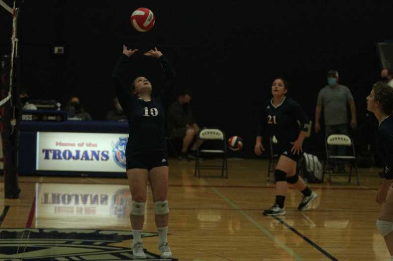 PMG PHOTO: TANNER RUSS - Senior setter Lydia Berning sets the ball for her outside hitter against the Columbia Christian Knights on Monday, Oct. 4.