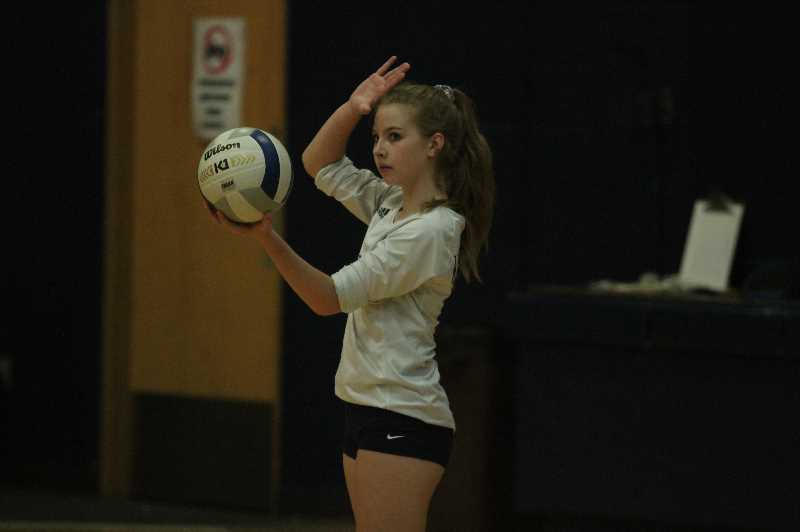 PMG PHOTO: TANNER RUSS - Junior Allison Gooley gets ready to serve the ball against the Columbia Christian Knights on Monday, Oct. 4.