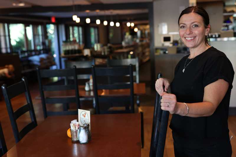 PMG PHOTO: JAIME VALDEZ - Sydney Sandmeyer is happy to be working a normal shift at Babica Hen Cafe but can't help but be concerned about the delta variant and what it could mean for her job and making sure her kids are being looked after.
