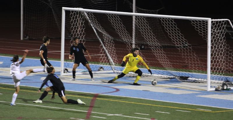 West Linn's Thomas Pierce scores in the first half against Three Rivers League leaders Lakeridge on Monday, Oct. 4.