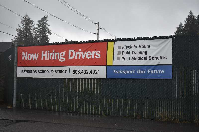 PMG PHOTO: ANGEL ROSAS - Reynolds School District has a sign outside its transportation lot promoting the districts bus driver openings. The sign has also been placed on buses and parked on corners of busy streets and intersections.