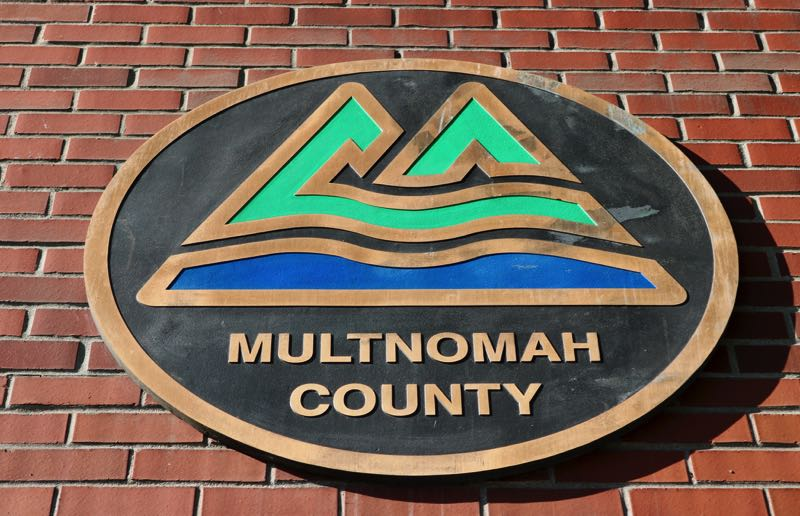 TRIBUNE PHOTO: ZANE SPARLING - A sign showing Multnomah County's logo is attached to the wall of the County's Southeast Hawthorne Boulevard building.