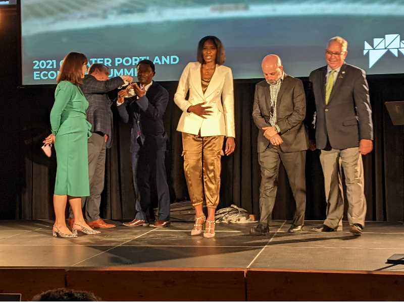 PMG PHOTO: JOSEPH GALLIVAN - Monique Claiborne, (in white jacket) the new CEO of Greater Portland Inc., with other speakers at the recent Econoomic Development Summit at the Redd in Portland. The message was that this city could bounce back like Detroit, but it will take better public-private partnerships.
