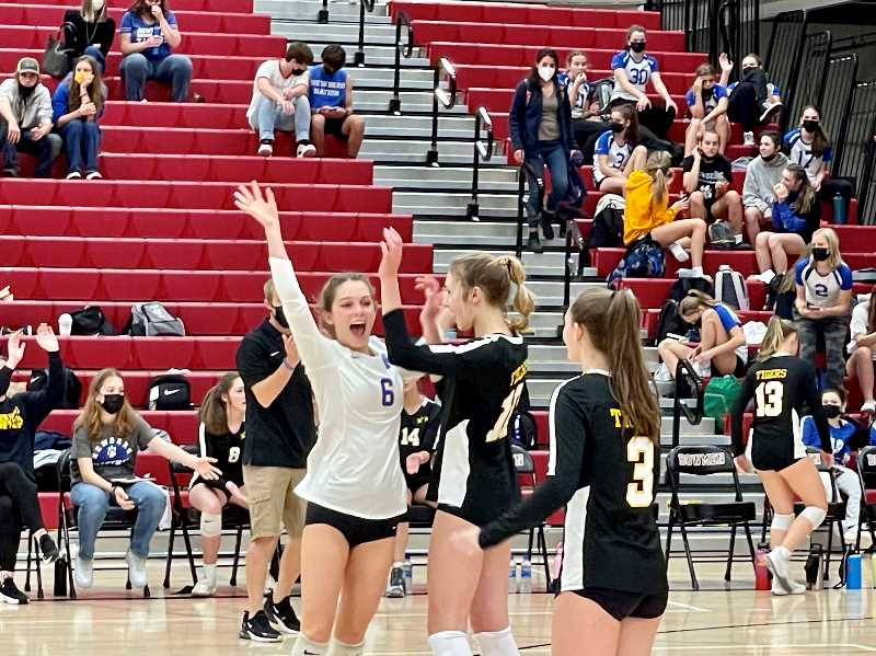 PMG PHOTO: RYAN CLARKE - The NHS volleyball team is close-knit with strong chemistry, a trait its coach says has led to the Tigers' success so far.