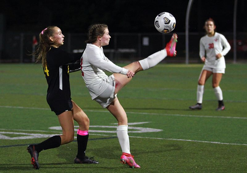 PMG PHOTO: MILES VANCE - Oregon City senior Amelia Spellman makes a kick during her team's 2-1 loss to West Linn at West Linn High School on Wednesday, Oct. 6.