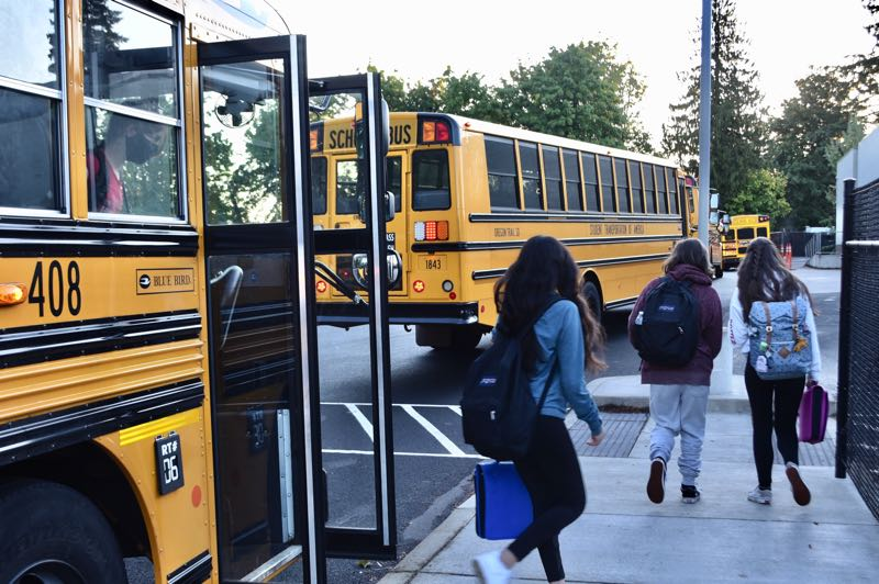 PMG PHOTO: BRITTANY ALLEN - Students arrive at Cedar Ridge Middle School on one of the 14 buses running in Oregon Trail School District.