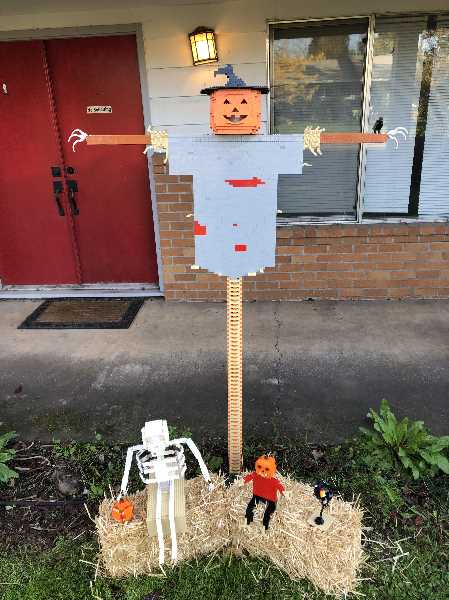 COURTESY PHOTO: CITY OF WOODBURN - 'Brick Crow Family' was the second-place winner of Woodburn's 2020 scarecrow contest.