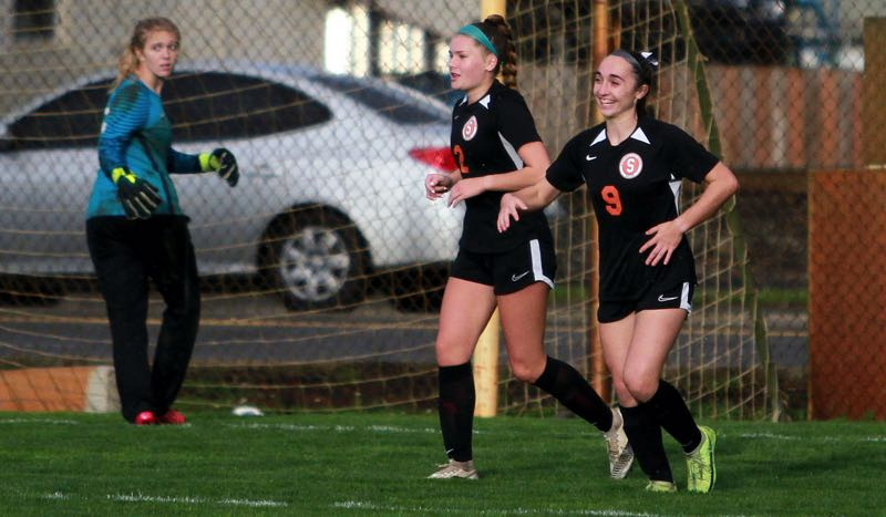 PMG PHOTO: MILES VANCE - Scappoose junior Kaylie Schrotzberger (right) is all smiles after scoring a goal during her team's 7-0 win over Milwaukie at Chinook Field on Wednesday, Oct. 6.