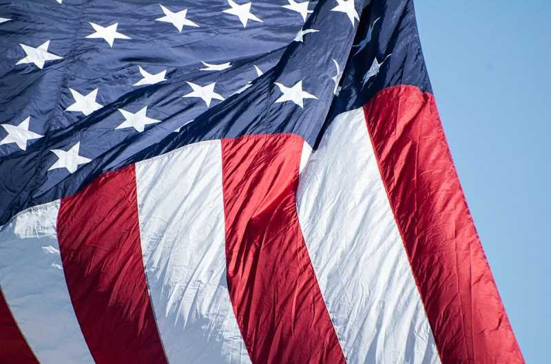 COURTESY PHOTO - The Forest Grove American Legion collects worn, torn, unusable flags year-round for proper disposal at an event in September., Hillsboro Tribune - Features  Forest Grove American Legion collects worn flags for disposal