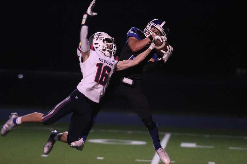 PMG PHOTO: TANNER RUSS - Woodburn senior Tomas Veliz was a force on offense and defense, getting two interceptions while playing corner. Woodburn beat Newport 44-7 on Thursday, Oct. 7.