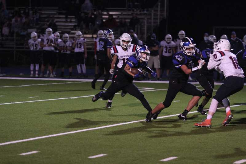 PMG PHOTO: TANNER RUSS - Woodburn junior Ty Beyer was part of a three-headed attack for the Bulldogs, alongside fellow running back Tomas Veliz and fullback Carter Pickett (No. 40).