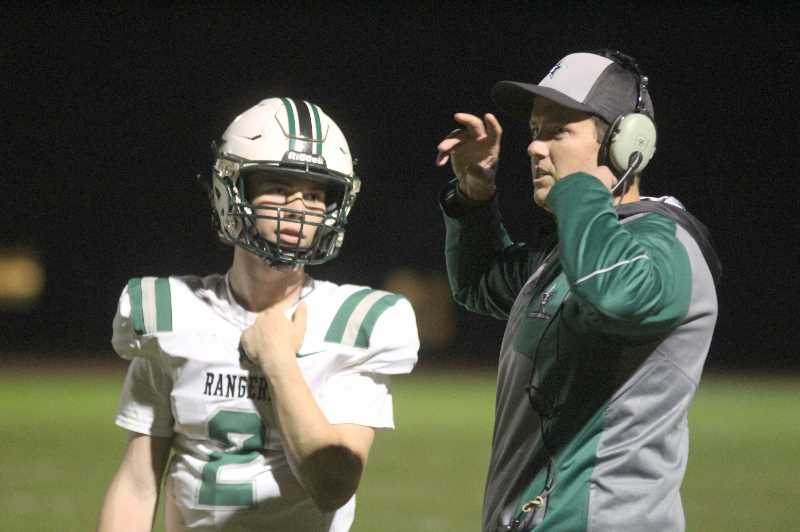 PMG PHOTO: ANDY DIECKHOFF - Estacada head coach Andy Mott is confident that quarterback Cory James and the rest of the Rangers can contend for a state title.