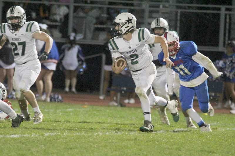 PMG PHOTO: ANDY DIECKHOFF - Estacada quarterback Cory James (2) ran for a touchdown and threw for another in the win over Madras.