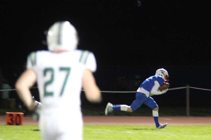 PMG PHOTO: ANDY DIECKHOFF - Cael White had 10 catches for 130 yards against No. 1 Estacada on Thursday night, recording season-highs in both categories.