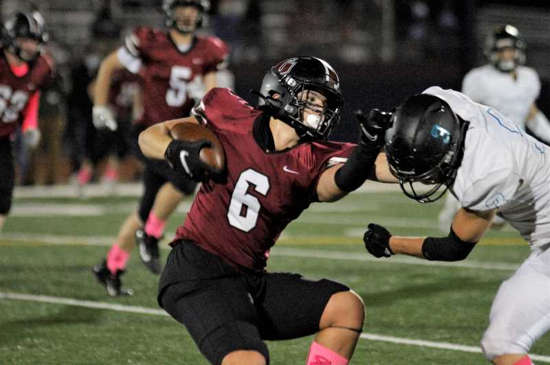 PMG PHOTO: WADE EVANSON - Glencoe's Zack Schlottmann fights-off a Century tackler during the Crimson Tide's game against the Jaguars Thursday night, Oct. 7, at Hare Field in Hillsboro.