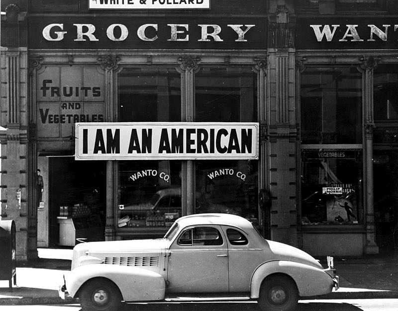 COURTESY PHOTO: NATIONAL ARCHIVES - This iconic 1942 image from photographer Dorothea Lange shows a sign placed in the window of an Oakland, California, store, on Dec. 8, 1941, the day after Pearl Harbor. The store was closed following orders to persons of Japanese descent to evacuate from certain West Coast areas. The owner, a University of California graduate, was sent with hundreds of evacuees to War Relocation Authority centers.