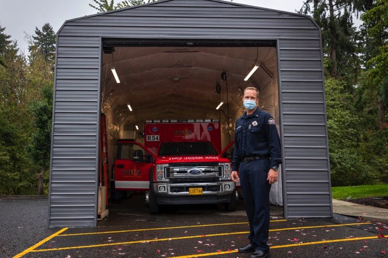 PMG PHOTO: JAIME VALDEZ - TVF&R Capt. Dan Mitchael, stands where the paramedic truck is housed at station 54 at Charbonneau fire station at the Northwest Spine and Laser Surgery building in Charbonneau.