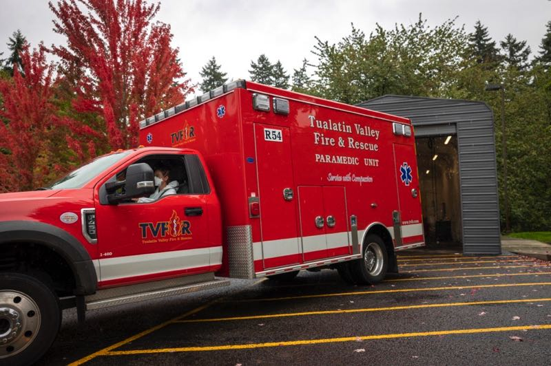 PMG PHOTO: JAIME VALDEZ - TVF&R firefighter paramedic Amy Boyle and Capt. Dan Mitchael (not pictured) leaves on a medical call at station 54 in Charbonneau.