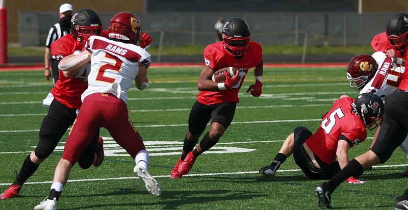 PMG. FILE PHOTO - Clackamas senior wide receiver K.J. Johnson-Gibson (shown here last spring against Central Catholic) helped lead the Cavaliers past Grant 48-14 at Franklin High School on Thursday, Oct. 7.