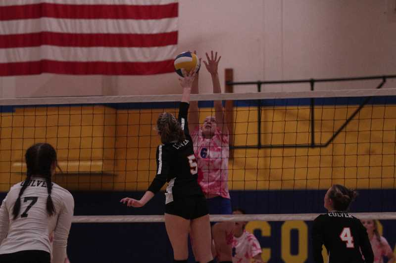 PMG PHOTO: TANNER RUSS - Gervais junior, Josie Schultz, gets the block at the net in the teams win over visiting Culver.