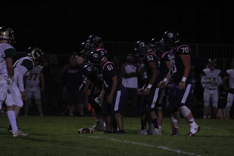 PMG PHOTO: TANNER RUSS - Kennedys offensive line put in work against the Regis Rams, grinding towards a 34-14 victory on Friday, Oct. 8.