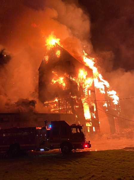 COURTESY PHOTO: MOUNT ANGEL FIRE DISTRICT - Firefighters for multiple districts were deployed early Saturday morning to battle a blaze that engulfed prominent Mount Angel buildings.