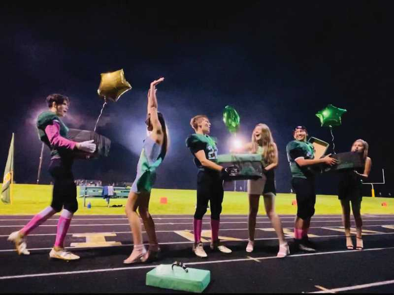 COURTEST PHOTO: KRISTIN THURSTON - The balloons fly at the Colton homecoming game announcing the king and queen. (From left) Dominic Combest-Day, Mikey Spalinger and senior court members.