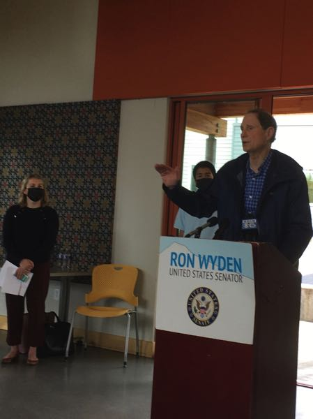 PMG PHOTO: PETER WONG - U.S. Sen. Ron Wyden, D-Ore., speaks at an event Friday, Oct. 2, in Southwest Portland with advocates for social supports and climate action in President Joe Biden's Build Back Better budget plan. Others are Hailey Adkisson and Yusuf Arifin.