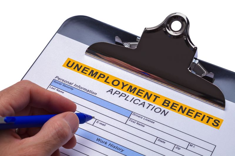 FILE - A person fills out an application for unemployment benefits.
