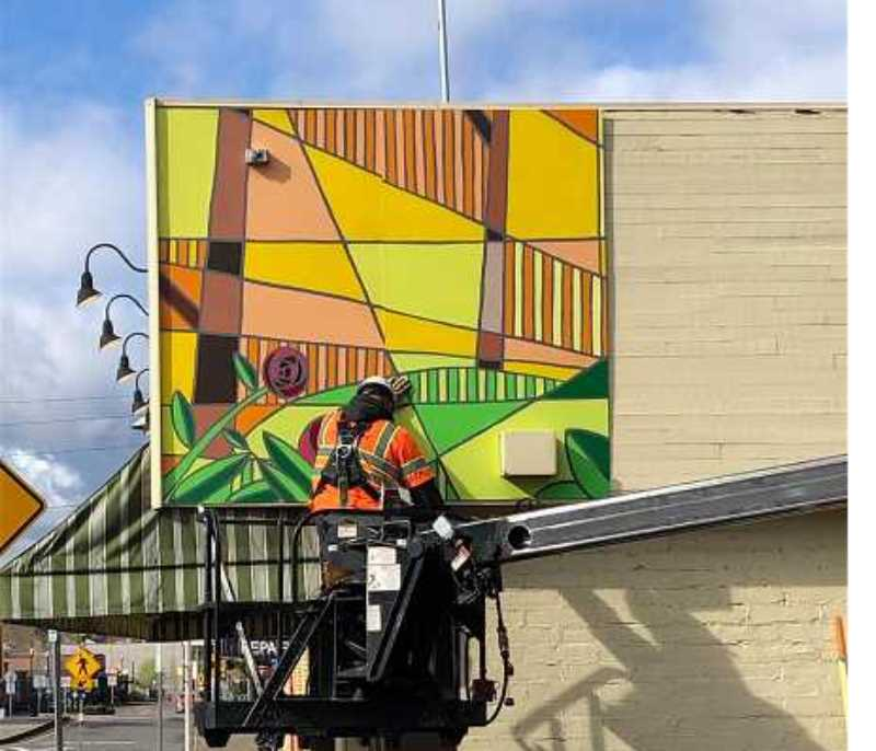 PMG FILE PHOTO - Tigard provided funds for a large paint-by-numbers-type mural, which was created last spring on the front of Main Street Stamp and Stationery. The mural recently received an Excellence on Main Street award from the Oregon Parks and Recreation Department.