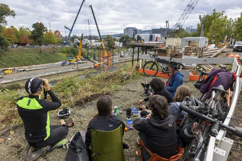 PMG PHOTO: JAIME VALDEZ - The $13.7 million Congressman Earl Blumenauer Bicycle and Pedestrian Bridge being moved into place Saturday Oct 8, where it will provide a new route over Interstate 84 when it opens in summer 2022.