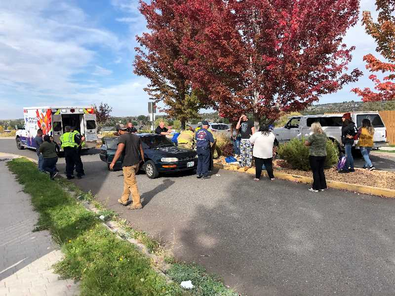 COURTESY PHOTO: MADRAS POLICE DEPARTMENT - Police say the car that hit an 8-year-old boy on Strawberry Lane in Madras dragged him for about 20 feet. Witnesses partially lifted the car so he could be removed from underneath. He was flown to St. Charles Bend for treatment of his injuries.
