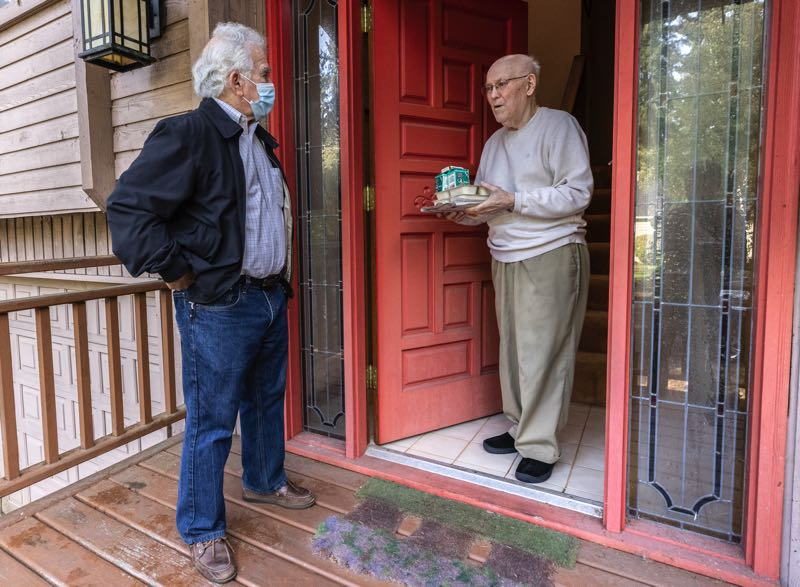 PMG FILE PHOTO - Lynn Brokaw drops food off for a Meals on Wheels recipient.
