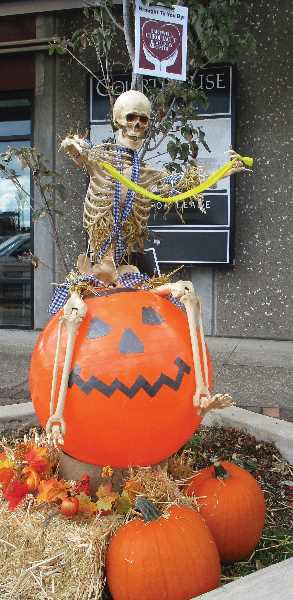 PMG PHOTO: DEBORAH GUINTHER - Lots of creativity goes into the scarecros displays in downtown Canby.