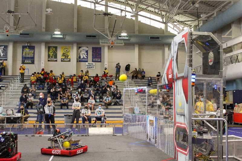 PMG PHOTO: MIA RYDER-MARKS - During the rounds, robotic teams shot foam balls through goals.