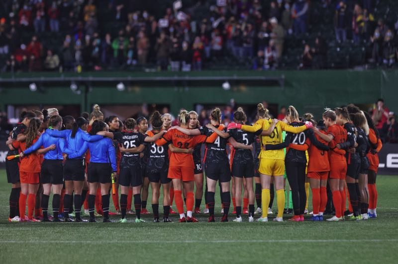 PMG STORY: JONATHAN HOUSE - In a show of unity, players, coaches and officials paused play  and gathered around the center circle at Providence Park in the sixth minute of the Portland Thorns home match Oct. 6 against the Houston Dash. The pause happened around the NWSL to honor players who have been abused by coaches. Just prior to this match, the Thorns placed general manager Gavin Wilkinson on administrative leave pending ongoing investigations into why Paul Riley was allowed to continue coaching after his 2015 dismissal from the Thorns.