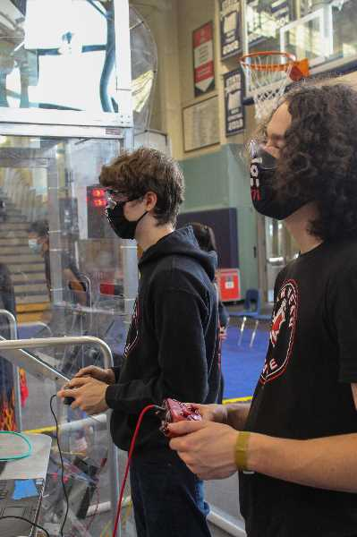 PMG PHOTO: MIA RYDER-MARKS - Video game controllers were used by teams to maneuver robots around the field.