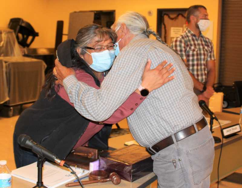 PMG PHOTO: HOLLY SCHOLZ - Laurie Danzuka received a congratulations hug from Jeff Sanders during the school board meeting in Warm Springs Oct. 11.