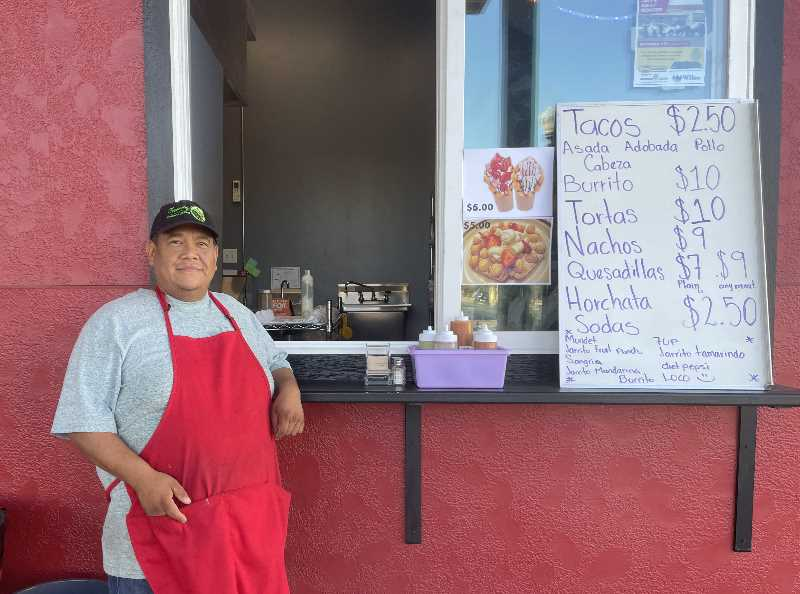 PMG PHOTO:  HOLLY SCHOLZ  - Hector Galan opened Le Burrito Loco last month at the old Sunshine Corner, now Reynoso Food Court, in downtown Madras. He is one of three new food vendors at the court.