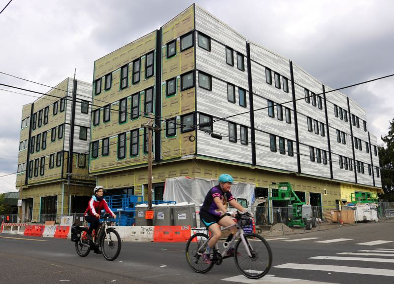 PMG PHOTO: ZANE SPARLING - Construction workers have nearly completed the new affordable housing project Mamook Tokatee in Northeast Portland's Cully neighborhood.